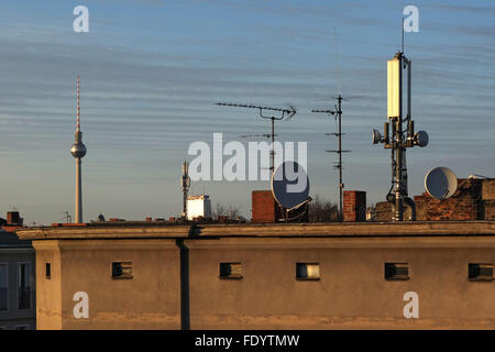 Berlin, Germany, radio masts, antennas and satellite bowls on a roof - Stock Photo