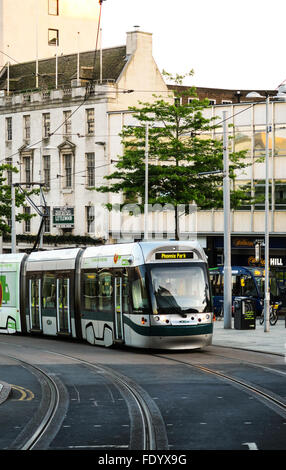 A city tram in the centre of Nottingham, UK. - Stock Photo