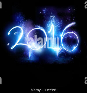 Happy New Year 2016. New year celebrations with 2016 sign lit up with fireworks. - Stock Photo