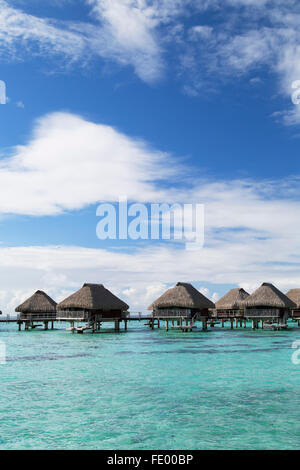Overwater bungalows of Hilton Mo'orea Lagoon Resort Hotel, Moorea, Society Islands, French Polynesia - Stock Photo