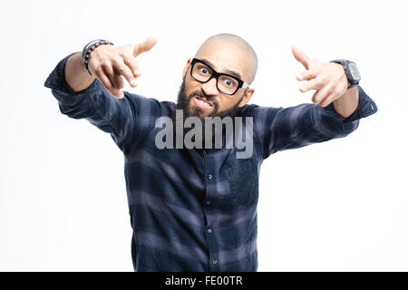 Angry aggressive african american baldheaded man with beard in glasses pointing to camera with both hands - Stock Photo