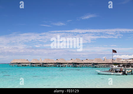 Overwater bungalows of Sofitel Hotel, Moorea, Society Islands, French Polynesia - Stock Photo