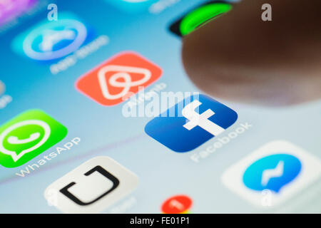 Facebook social media app logo on screen of a  smart phone - Stock Photo