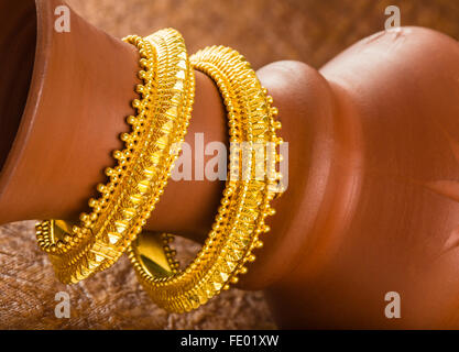 gold jewelry, gold bangles, Indian jewelry design, Indian contemporary gold jewelry, golden jewelry on display, - Stock Photo