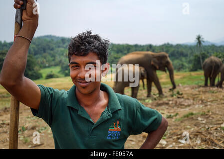 Elephant handler at Pinnawala Elephant Orphanage - Stock Photo