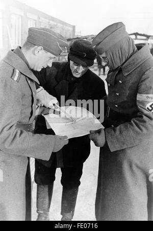 The Nazi propaganda picture shows the construction manager and construction workers of the Todt Organisation during - Stock Photo