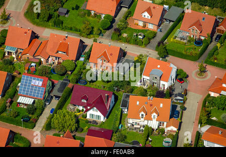 Aerial view, housing estate, brick buildings with red tile roofs, houses and semi-detached houses, gardens, Billerbeck, - Stock Photo
