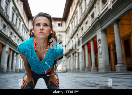 Now it is time to invest in your body and no matter you are at hometown or traveling. Sporty woman with earphones - Stock Photo
