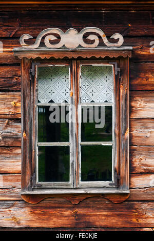 Rustic wooden window of a log house - Stock Photo