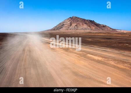 Sandy desert road on Sal Island, Cape Verde - Stock Photo
