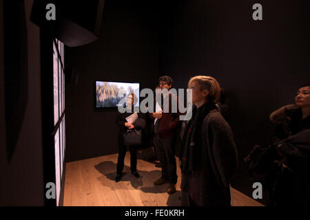 New York City, NY, USA. 3rd February, 2016. Visitors look at a series of panels representing FBI surveillance files - Stock Photo