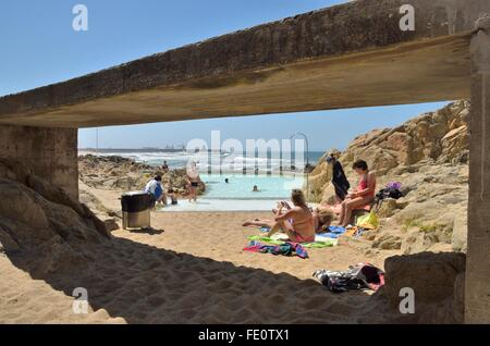 People at the natural swimming pools on the beach of Leca da Palmeira which is located north of the city of Matosinhos, - Stock Photo