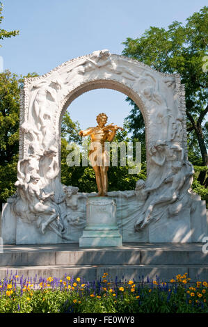The gold coloured Johann Strauss monument statue in Stadtpark, Vienna - Stock Photo
