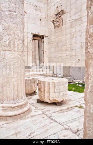Marble remains of walls and columns  located in the Acropolis of Athens. - Stock Photo
