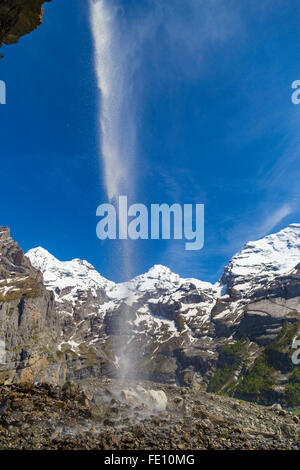 Swiss Alps waterfall near Oeschinensee Lake in Bernese Oberland, Switzerland - Stock Photo