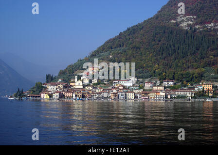 Town of Peschiera Maraglio. Country viewed from the Iseo lake in Lombardy region of Italy - Stock Photo