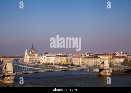 the Chain Bridge over the Danube River near the Parliament buildings of Budapest Hungary a beautiful cityscape - Stock Photo