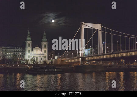 Elizabeth Bridge and the St. Stephen's Basilica, Danube River Budapest Hungary in the evening under a full moon - Stock Photo
