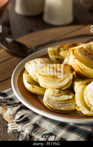 Organic Baked Fennel Bulbs with Salt and Pepper - Stock Photo