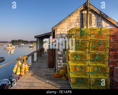 Central coast, Maine: Lobster traps and shed in fishing village of Friendship - Stock Photo