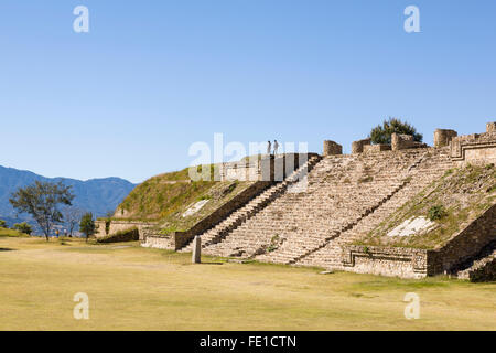 Tourists couple visiting ruins of a stone pyramid at Monte Alban, a World Heritage archaeological site, Oaxaca, - Stock Photo