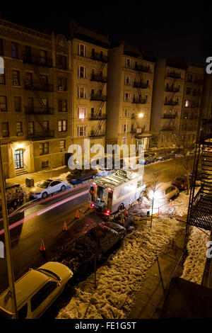 Con Edison Work Van parked on a New York Street beside a steaming manhole on a cold New Year's Eve night in New - Stock Photo