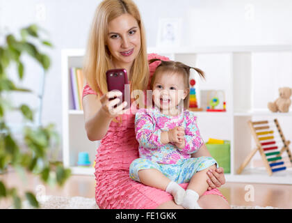 Mother and daughter taking selfie - Stock Photo