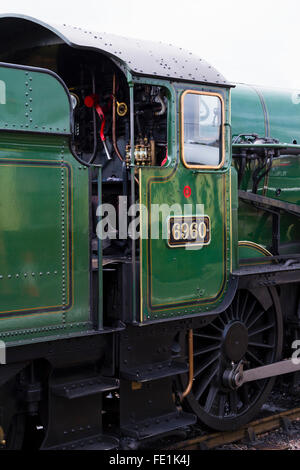 Steam train stopped at Watchet Station on the West Somerset Railway, UK - Stock Photo