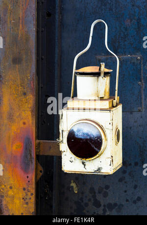 An old lantern on the front of an old steam train, part of the West Somerset Railway - Stock Photo