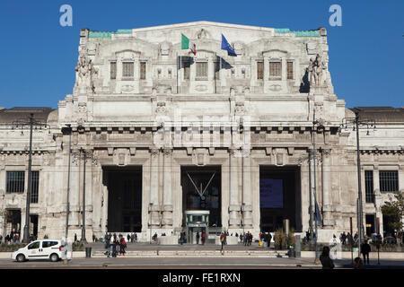 Main facade of the Central train station (Stazione di Milano Centrale) at Piazza Duca d'Aosta in Milan, Lombardy, - Stock Photo