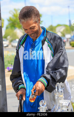 Man with Traumatic Brain Injury shopping for perfume - Stock Photo