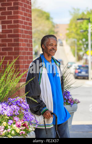 Man with Traumatic Brain Injury shopping for flowers - Stock Photo