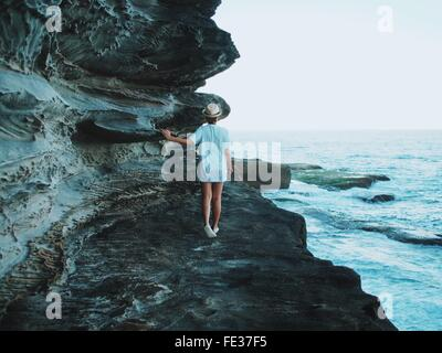 Young Woman Looking At Sea - Stock Photo