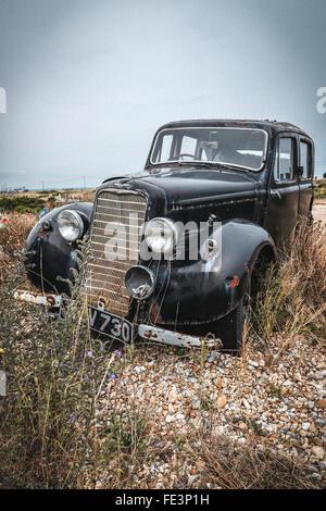 Old Hillman car on Dungeness Beach, Kent, UK - Stock Photo