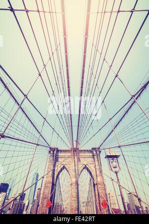 Vintage toned wide angle photo of Brooklyn Bridge, NYC, USA.