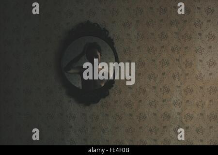 Man Reflecting In Mirror - Stock Photo