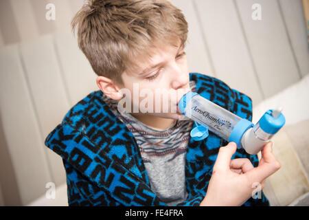 Blue reliever inhaler salbutamol inhaler asthma on a white