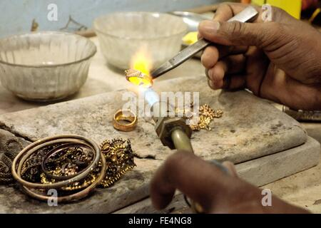 Goldsmith Working With A Unfinished Ring - Stock Photo