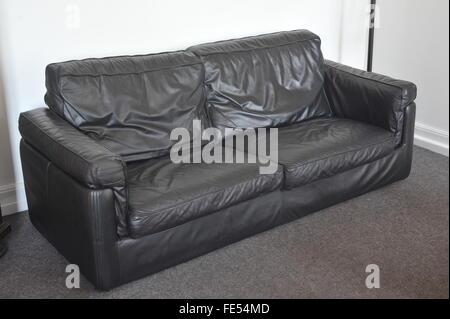 used black leather sofa, furniture, lounge - Stock Photo