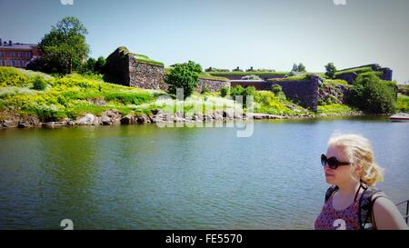 Woman Standing At River Bank - Stock Photo