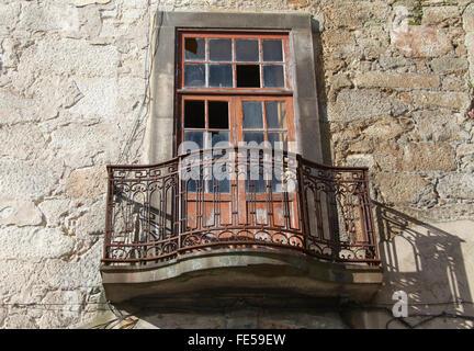 Old window in the Portuguese city of Porto - Stock Photo