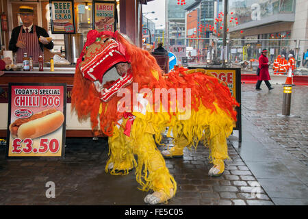 Chinese New Year, Manchester, UK. 4th Feb 2016.  Dancers perform a traditional Dragon dance for the visitors to - Stock Photo