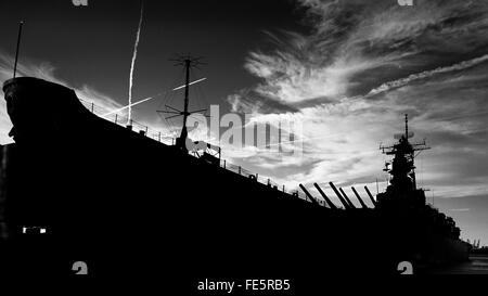 Low Angle View Of Silhouette Us Navy Ship Against Cloudy Sky - Stock Photo