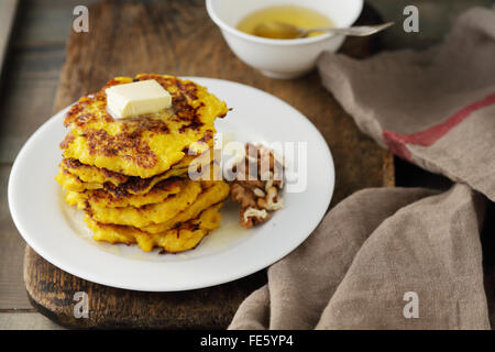 sweet pumpkin pancakes with butter, food - Stock Photo