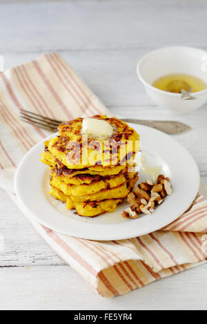 stack of pumpkin fritters on white plate - Stock Photo