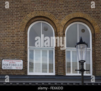 Two arched windows and a street lamp at Portobello Road in London W10 with the Portobello Road street sign. - Stock Photo