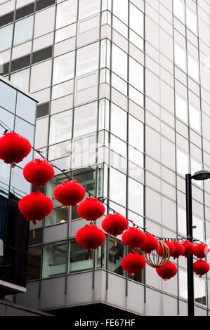 Low Angle View Of Red Lanterns Hanging In Front Of Buildings - Stock Photo