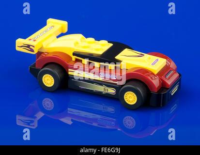 Lego racer toy car on blue background - Stock Photo