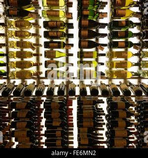 Wine Bottles On Shelves - Stock Photo