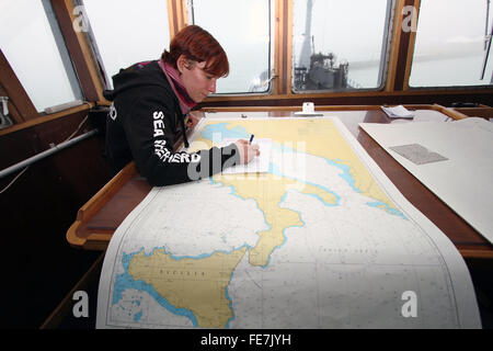 Venice, Italy. 3rd February, 2016. A member of crew of the Bob Barker ship with navigation chart in the control - Stock Photo